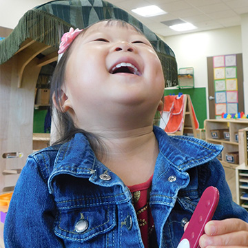 young girl laughing in classroom